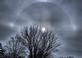 Sun shining through clouds in gray sky as winter storm approaches.. Taken 01/10/20 West end of Dubuque, Iowa. by Kay Munson.
