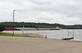 A barge goes up the Mississippi river at a park. Taken June 11, 2018 A. Y. McDonald park, Dubuque, IA by Veronica McAvoy.