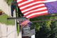 American flags in a row on a street.. Taken June 21,2016 Clayton, Iowa by Veronica McAvoy.