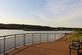 A barge goes up the Mississippi river near a park.. Taken June 11, 2018 A. Y. McDonald park, Dubuque, IA by Veronica McAvoy.