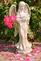 Roses and petals surround a garden statue. Taken June 14, 2016 Backyard deck by Deanna Tomkins.