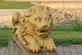 Golden lion statue at rest on a river-walk.. Taken August 18, 2018 Bellevue, Jackson county, IA by Veronica McAvoy.