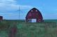 An old red barn stands next to modern technology-a windturbine.. Taken October 9, 2021 Hwy 81 near Darlington, WI by Veronica McAvoy.