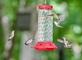 Hummingbirds gather around feeder in droves. Taken July 19, 2020 Pikes Peak State Park, near McGregor  by Deanna Tomkins.