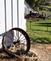 Wagon wheel sits alongside a restored barn. Taken September 24, 2017 Kaufman Farm, St. Donatus by Deanna Tomkins.