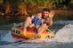 Father and son with different views about  tubing. Taken this summer on the river by Dawn Pregler.