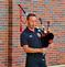 Fireman plays the bag-pipes.. Taken August 16, 2019 Iowa street firedepartment, Dubuque, IA by Veronica McAvoy.