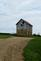 View of a spring house from a gravel road.. Taken July 30, 2018 US Hwy 52 south, Dubuque county, IA by Veronica McAvoy.