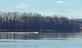 A motor boat cruises down the river.. Taken March 16, 2020 Riverwalk, Dubuque, IA by Veronica McAvoy.
