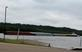 A barge goes up the Mississippi river.. Taken June 11, 2018 A. Y. McDonald park, Dubuque, IA by Veronica McAvoy.