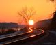 Sun warms railroad tracks along the river. Taken January 1, 2017 Mines of Spain by Deanna Tomkins.