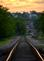 Railroad tracks glow from the reflection of the sun. Taken in June in Dubuque by Lorlee Servin.
