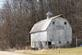 A old grey barn sits near a road.. Taken March 10, 2017 Old Davenport road by Veronica McAvoy.