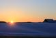 The sun sets along a hillside by a barn.. Taken February 11, 2018  Hwy US 52, dubuque, county, IA by Veronica McAvoy.