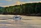 A boat travels down the river in the early morning.. Taken July 5, 2021 Dubuque, Iowa by Veronica McAvoy.