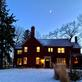 Home lit for the holidays with beautiful crescent moon lighting the sky!. Taken December 31, 2019 W. Third St. Historic Preservation District by Kay Munson.